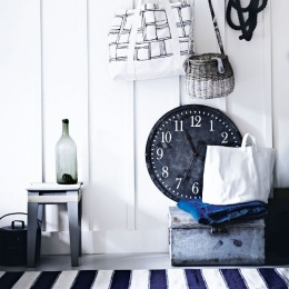 white-hallway-with-oversized-clock